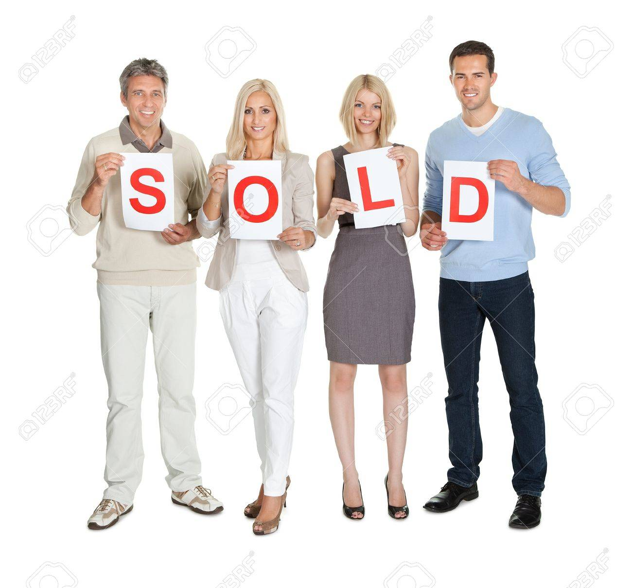 Happy group of people holding sold sign isolated on white background Stock Photo - 11582953