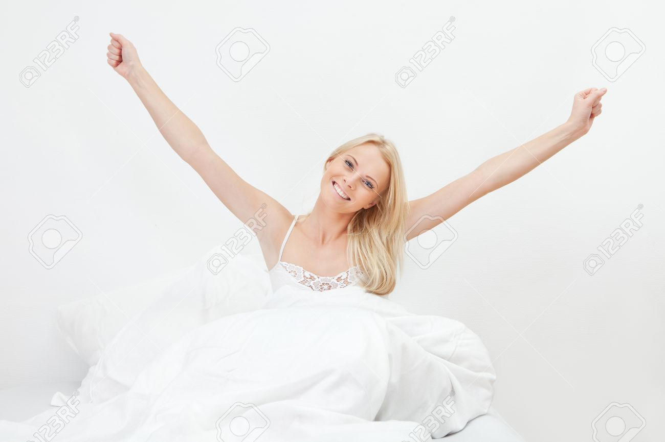 Young happy smiling woman waking up Stock Photo - 12475390