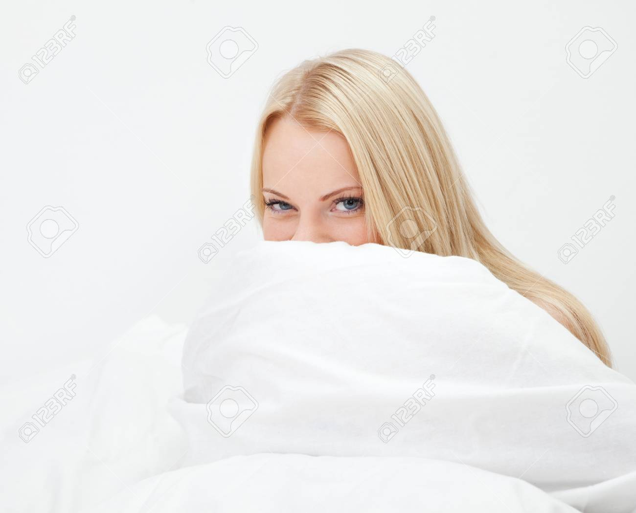 Young happy smiling woman waking up Stock Photo - 12475410