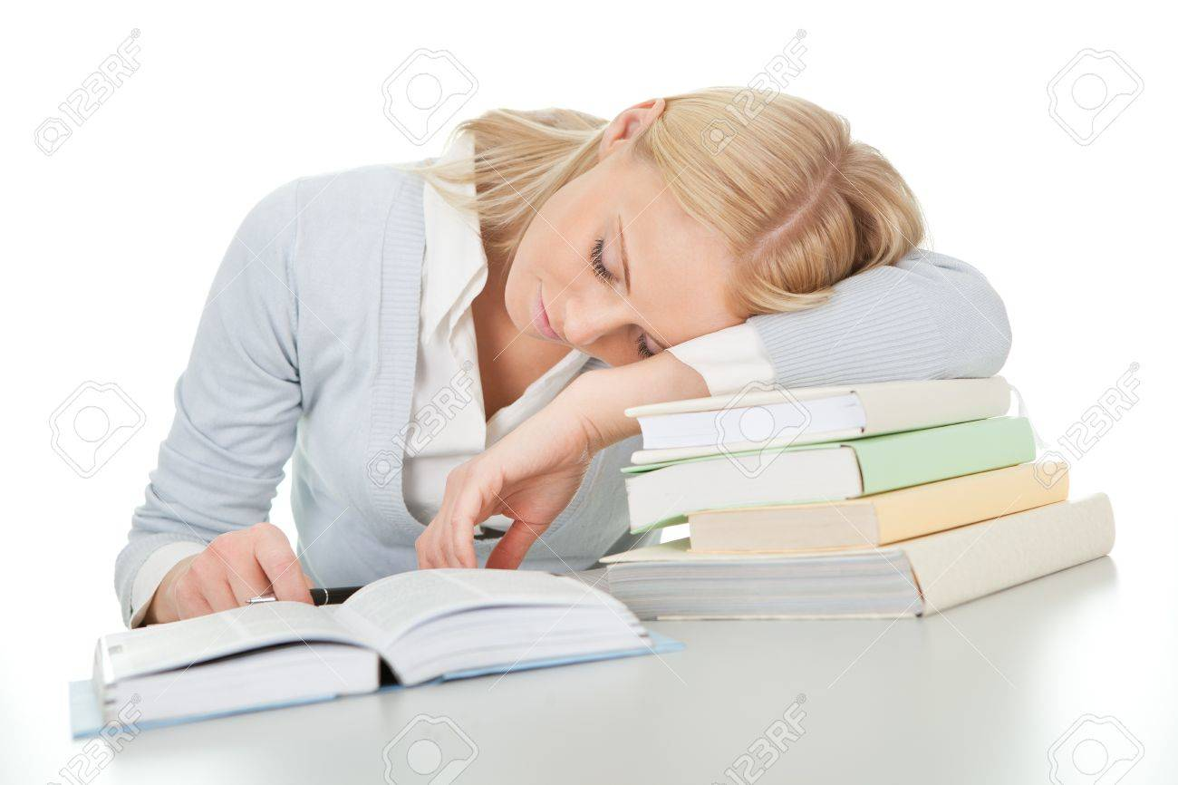 Beautiful student girl tired from doing homework Stock Photo - 12475477