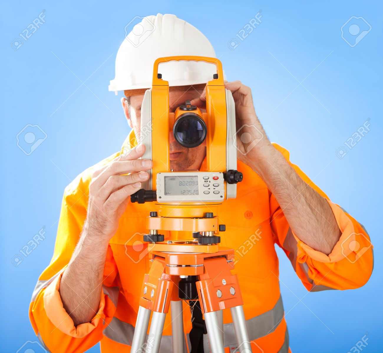 Portrait of Senior land surveyor working with theodolite at construction site Stock Photo - 12983557