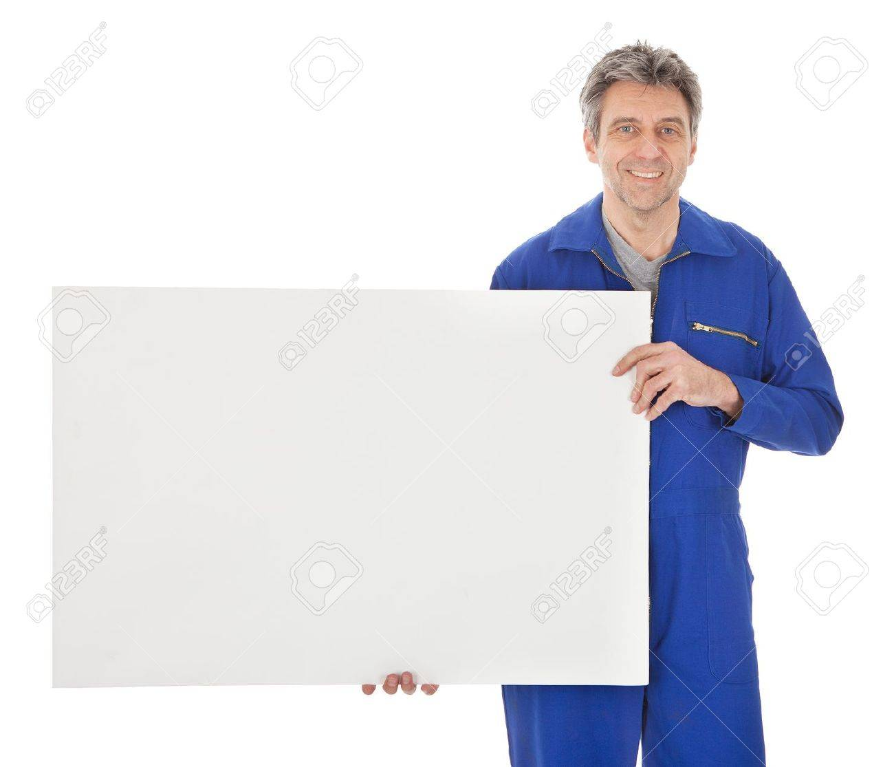Portrait of automechanic holding empty banner. Isolated on white Stock Photo - 12983454