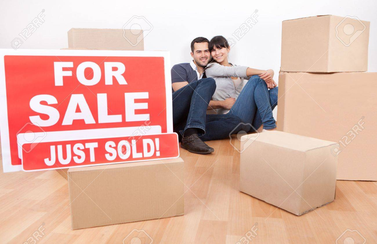 Happy young couple moving into new house Stock Photo - 13020621