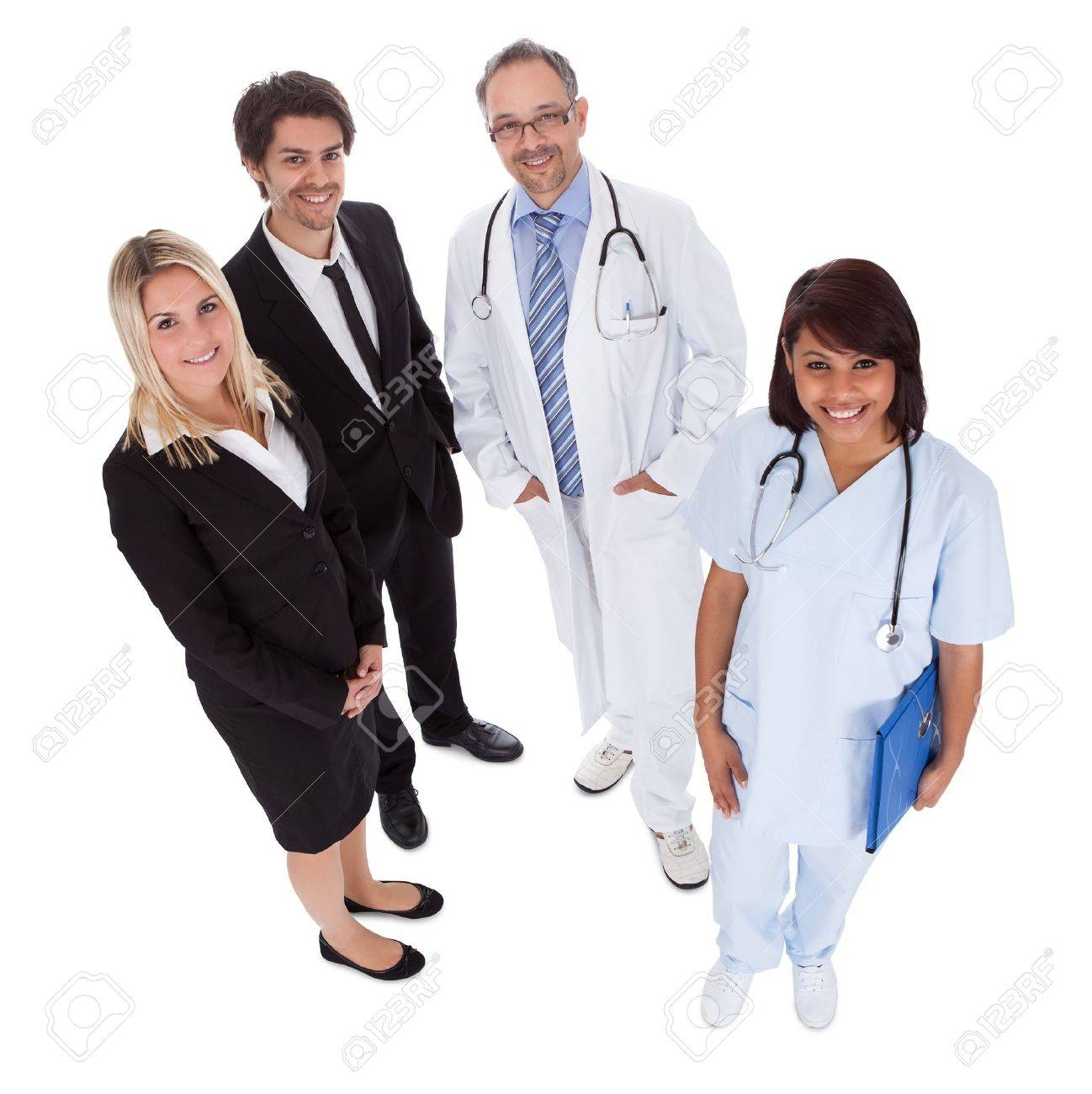 Portrait of businesspeople and medical workers standing on white background Stock Photo - 13888334