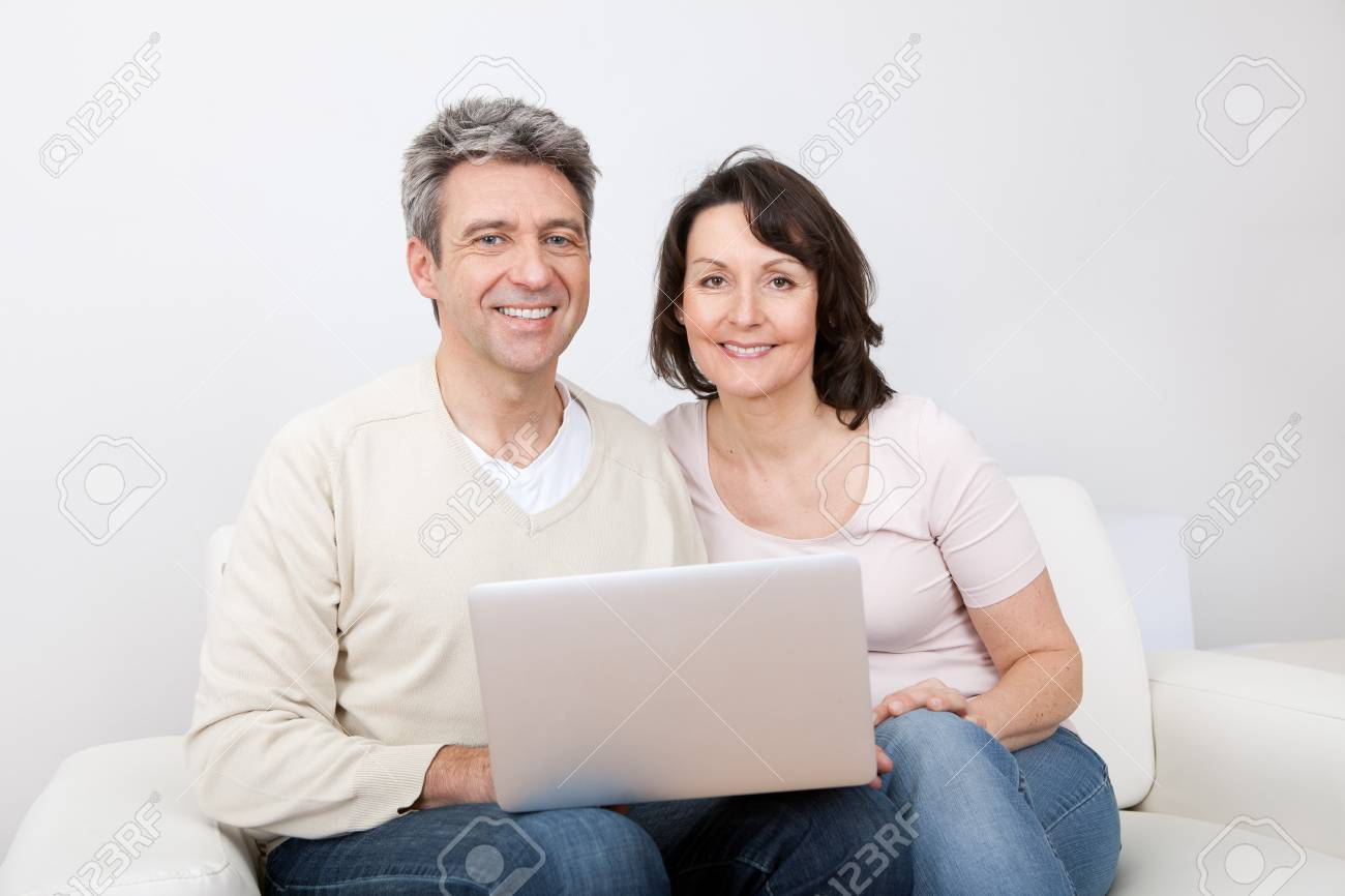 Mature couple shopping in internet using laptop at home Stock Photo - 13908032