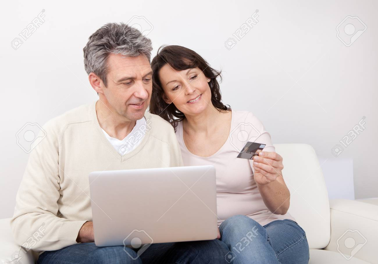 Mature couple shopping in internet using laptop at home Stock Photo - 13908020
