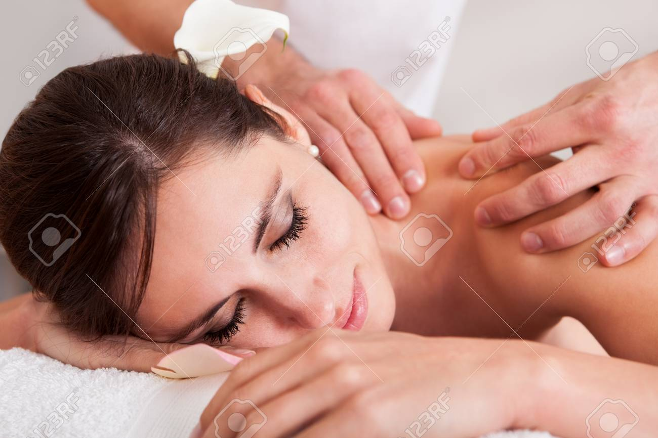 Beautiful young woman getting shoulder massage at spa Stock Photo - 14012003