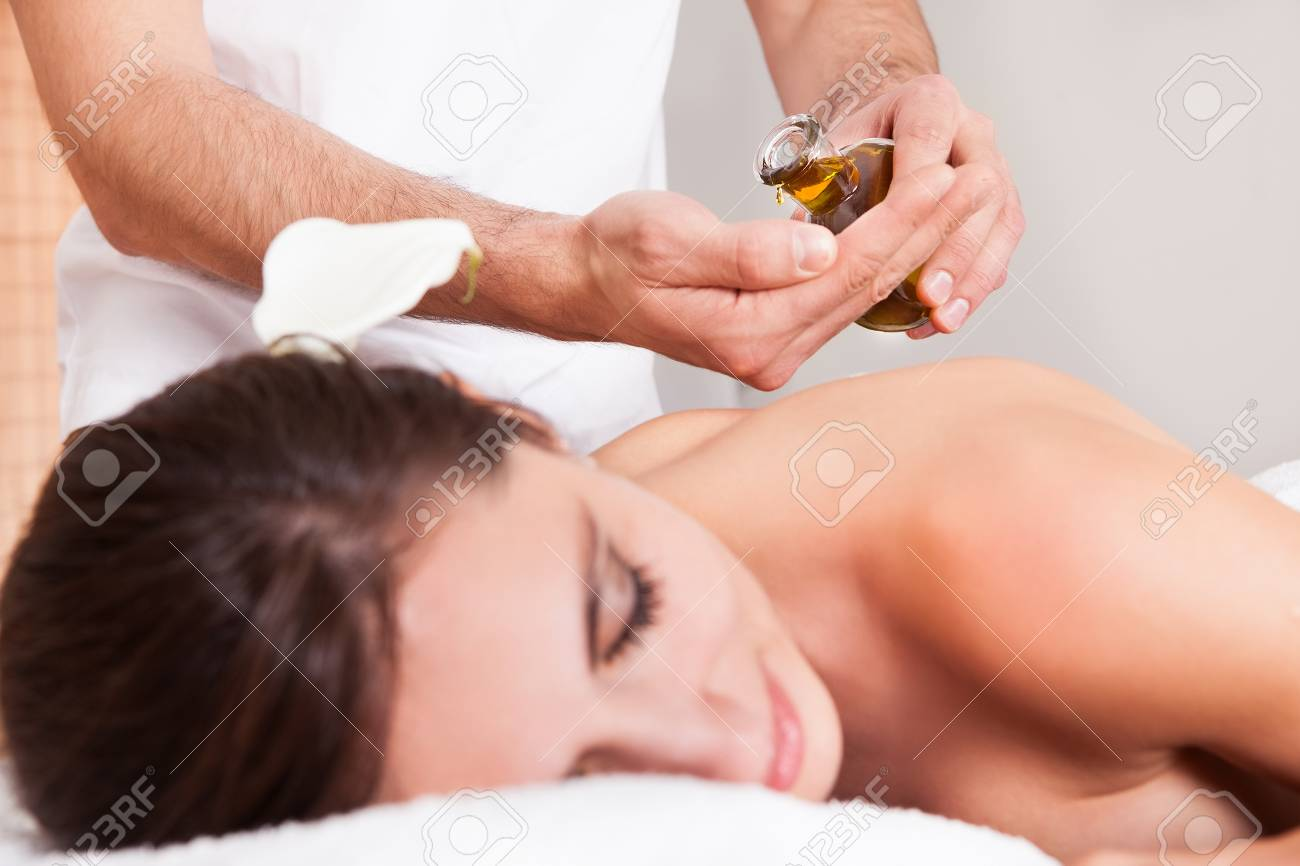 Beautiful young woman getting back massage at spa Stock Photo - 14011628