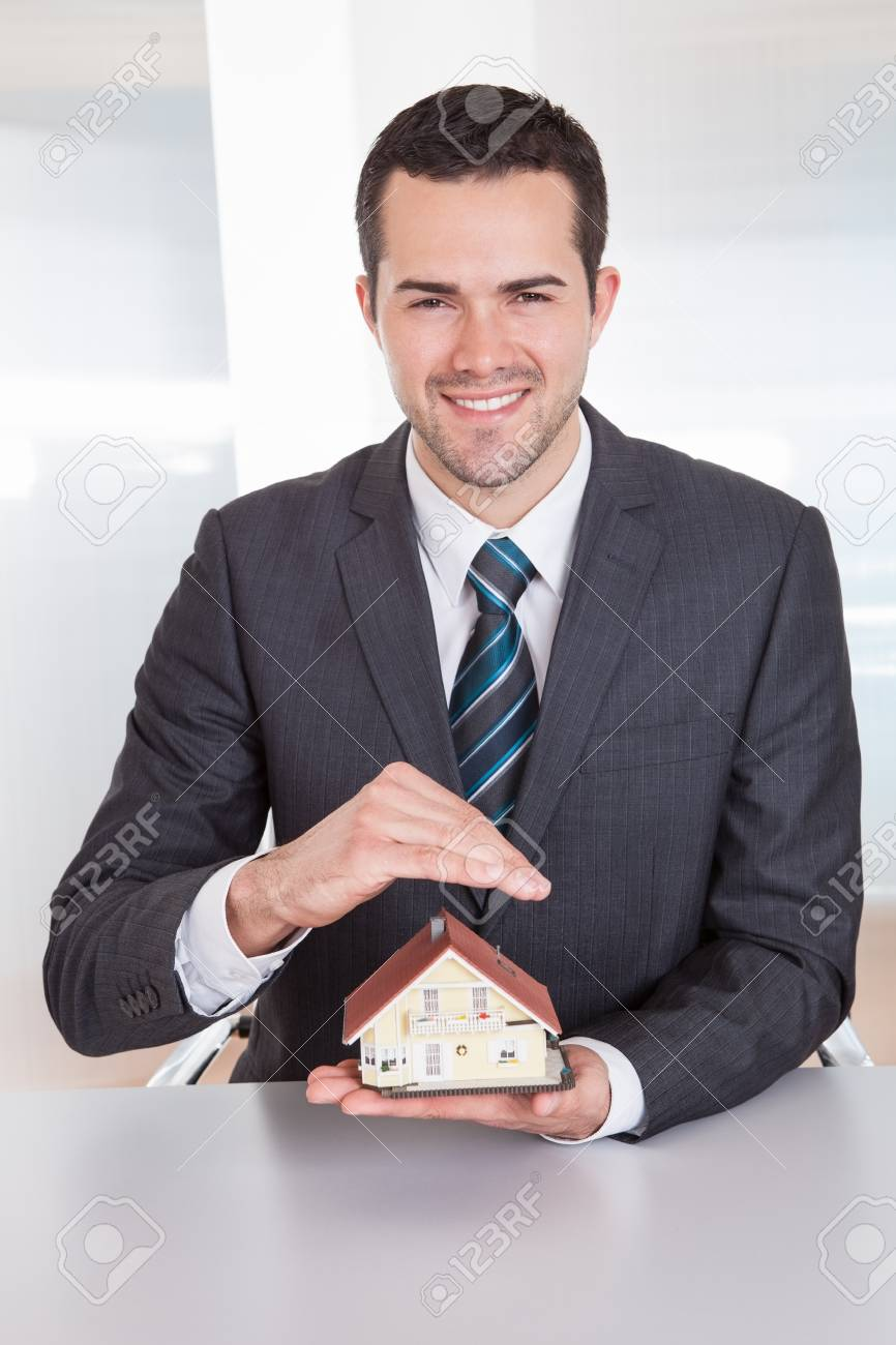 Successful businessman presenting model of the house Stock Photo - 14919189