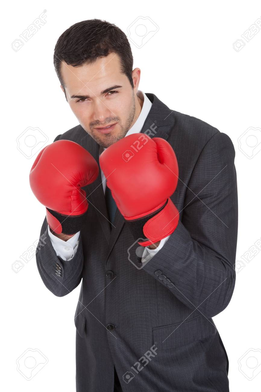 Competitive businessman in boxing gloves. Isolated on white Stock Photo - 14929348