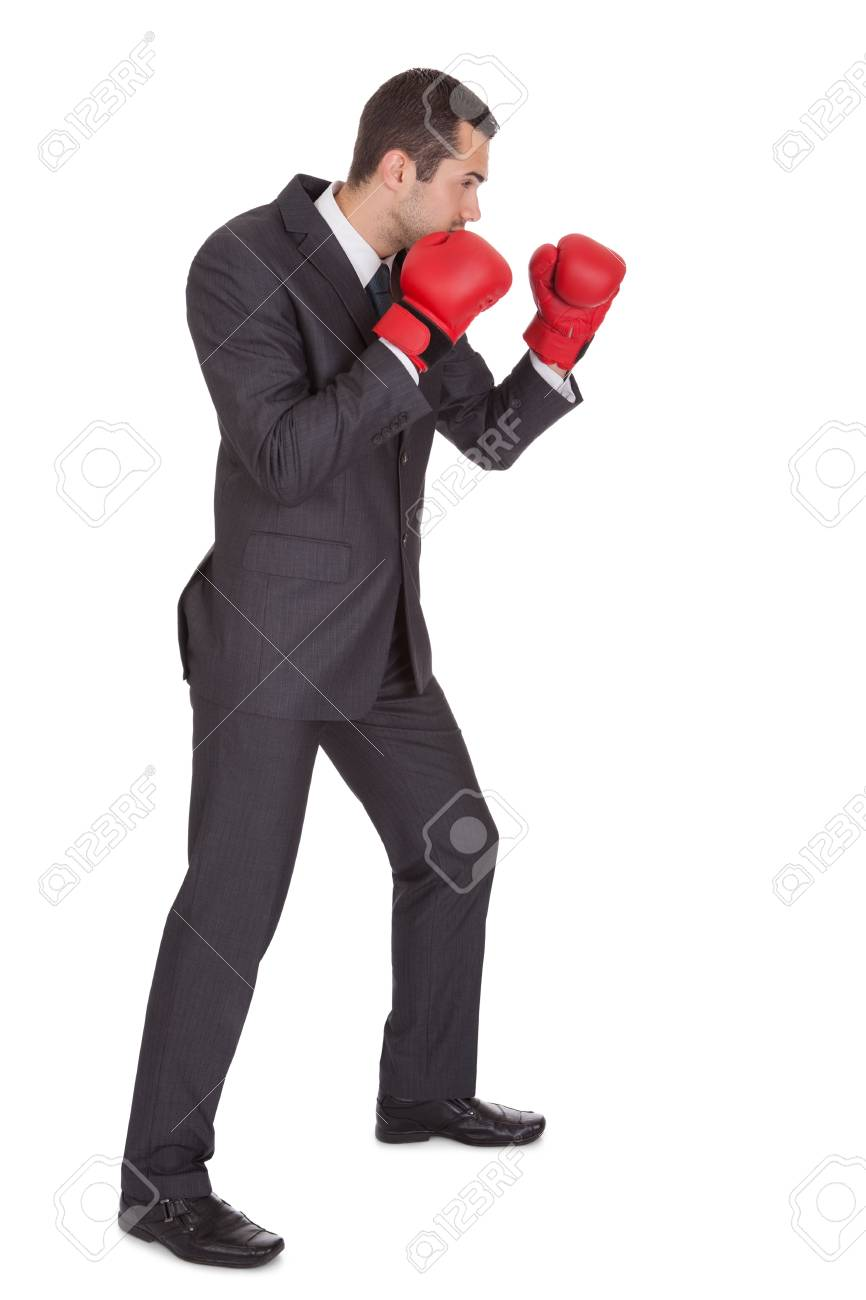 Competitive businessman in boxing gloves. Isolated on white Stock Photo - 15000792