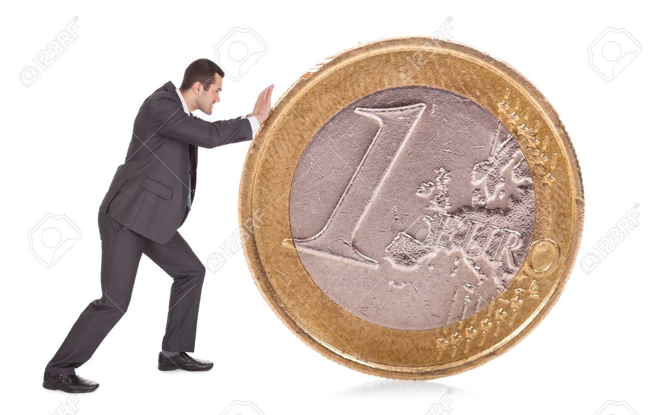 Successful businessman pushing one euro coin. Isolated on white Stock Photo - 14928965