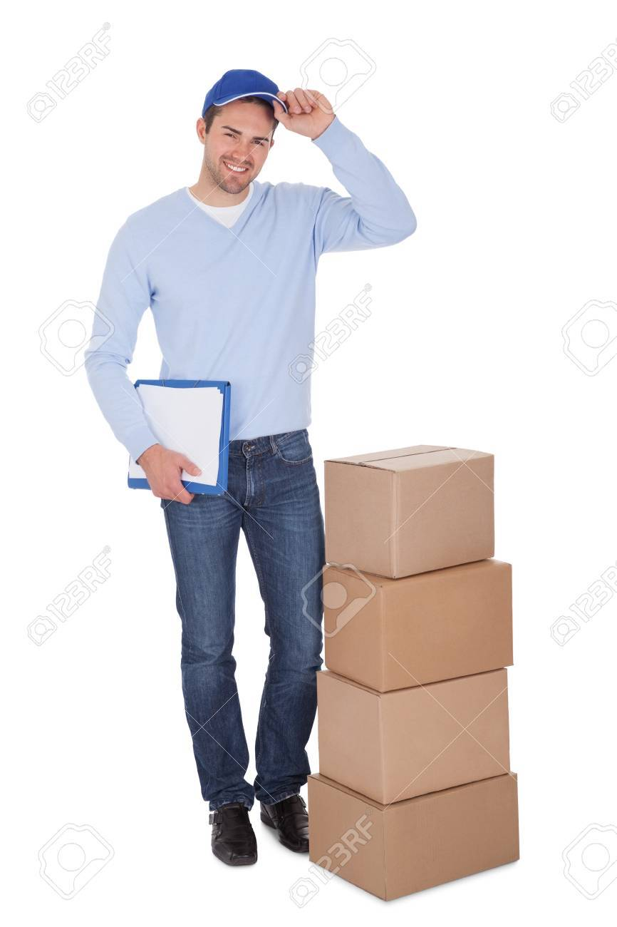 Smiling young delivery man holding stack of boxes. Isolated on white Stock Photo - 15000960