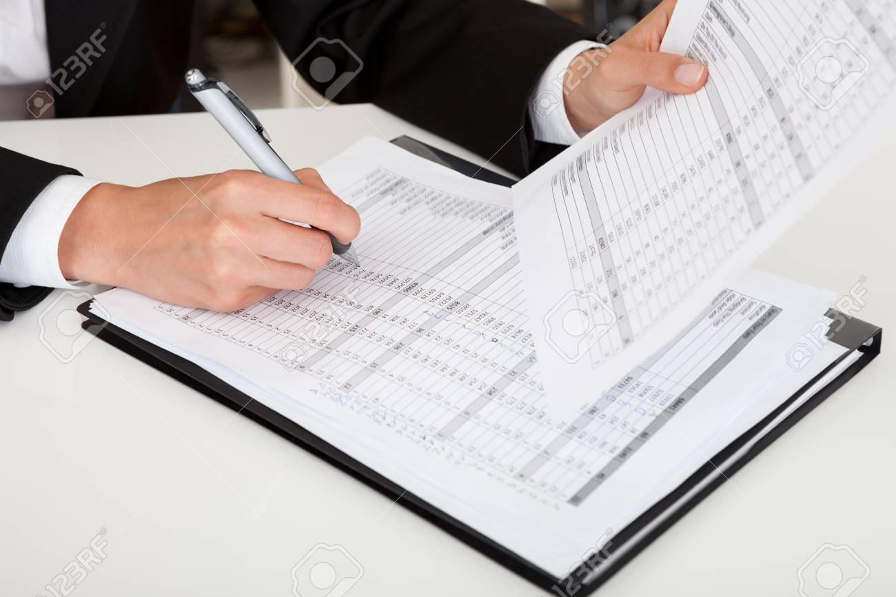 Midsection of a businesswoman with paperwork at office desk Stock Photo - 15133388
