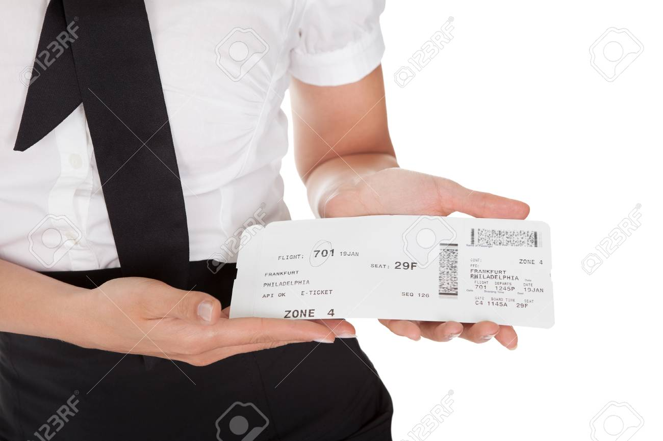 Smiling welcoming hospitality hostess presenting a voucher in her hands isolated on white Stock Photo - 15133564