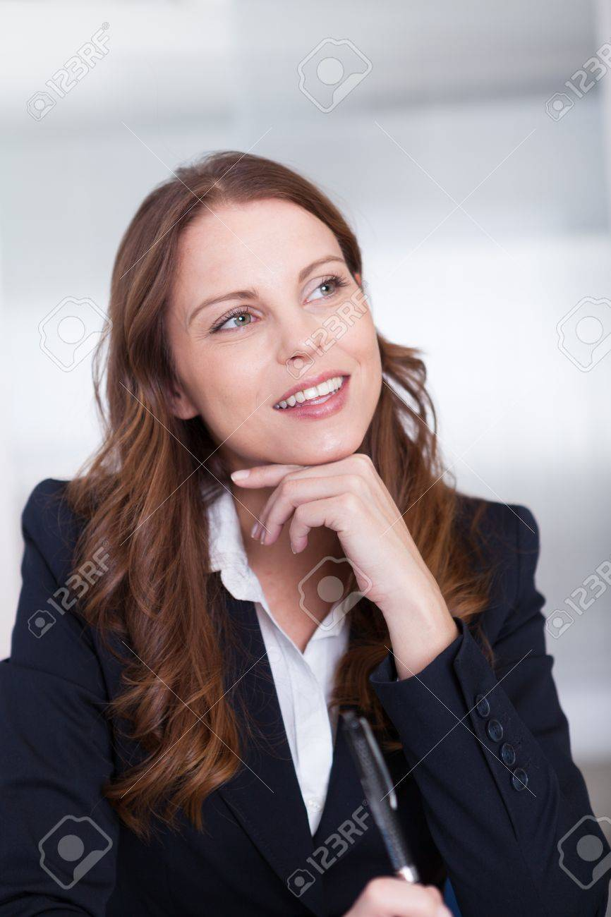 Smiling professional business secretary or personal assistant working at her computer typing on the keyboard Stock Photo - 15175665