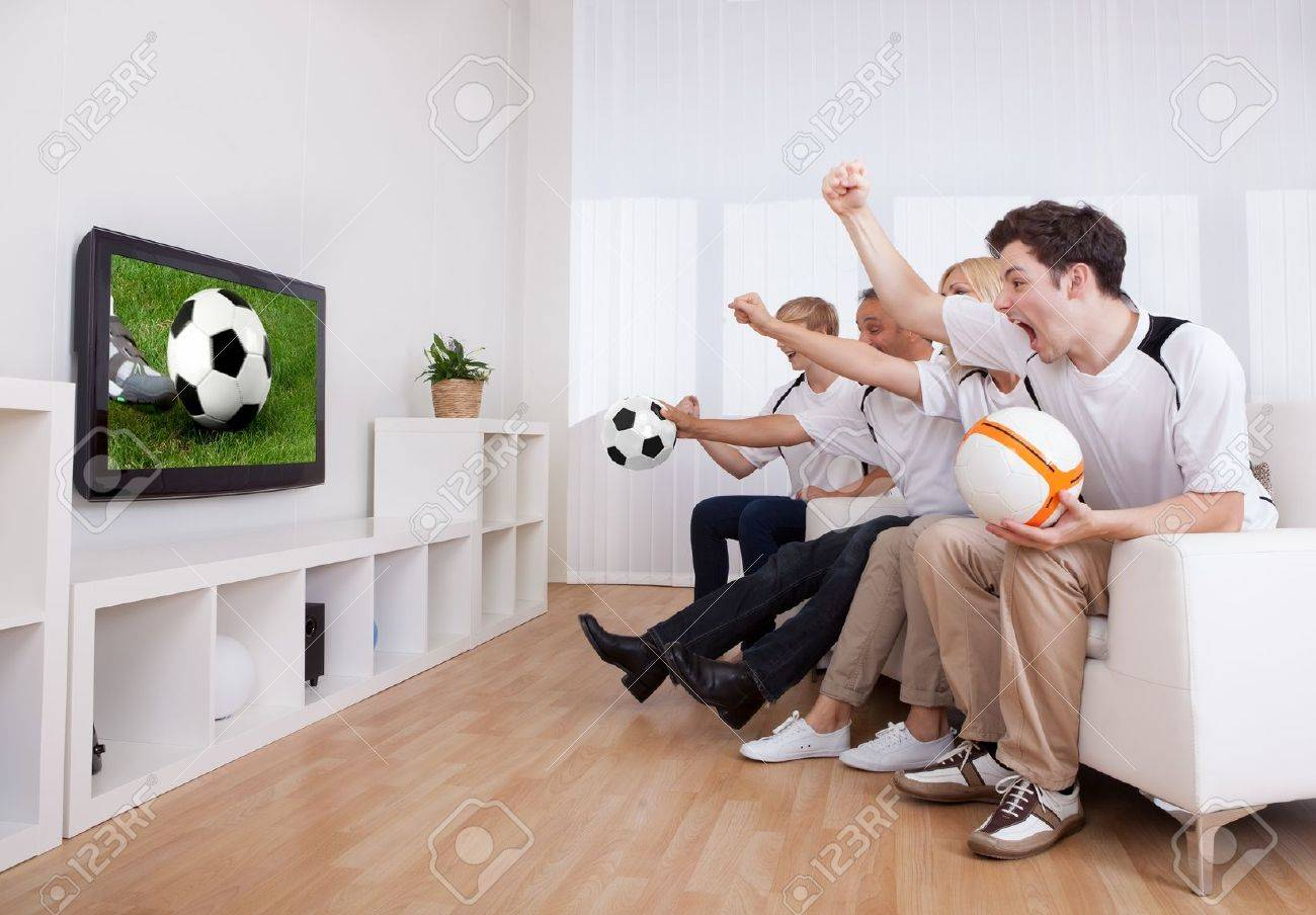 http://previews.123rf.com/images/andreypopov/andreypopov1209/andreypopov120900609/15500702-Jubilant-family-watching-television-as-they-cheer-on-their-home-side-in-a-sporting-competition-Stock-Photo.jpg
