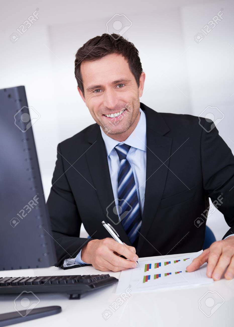 Portrait Of Happy Businessman At Workplace In the Office Stock Photo - 15403711