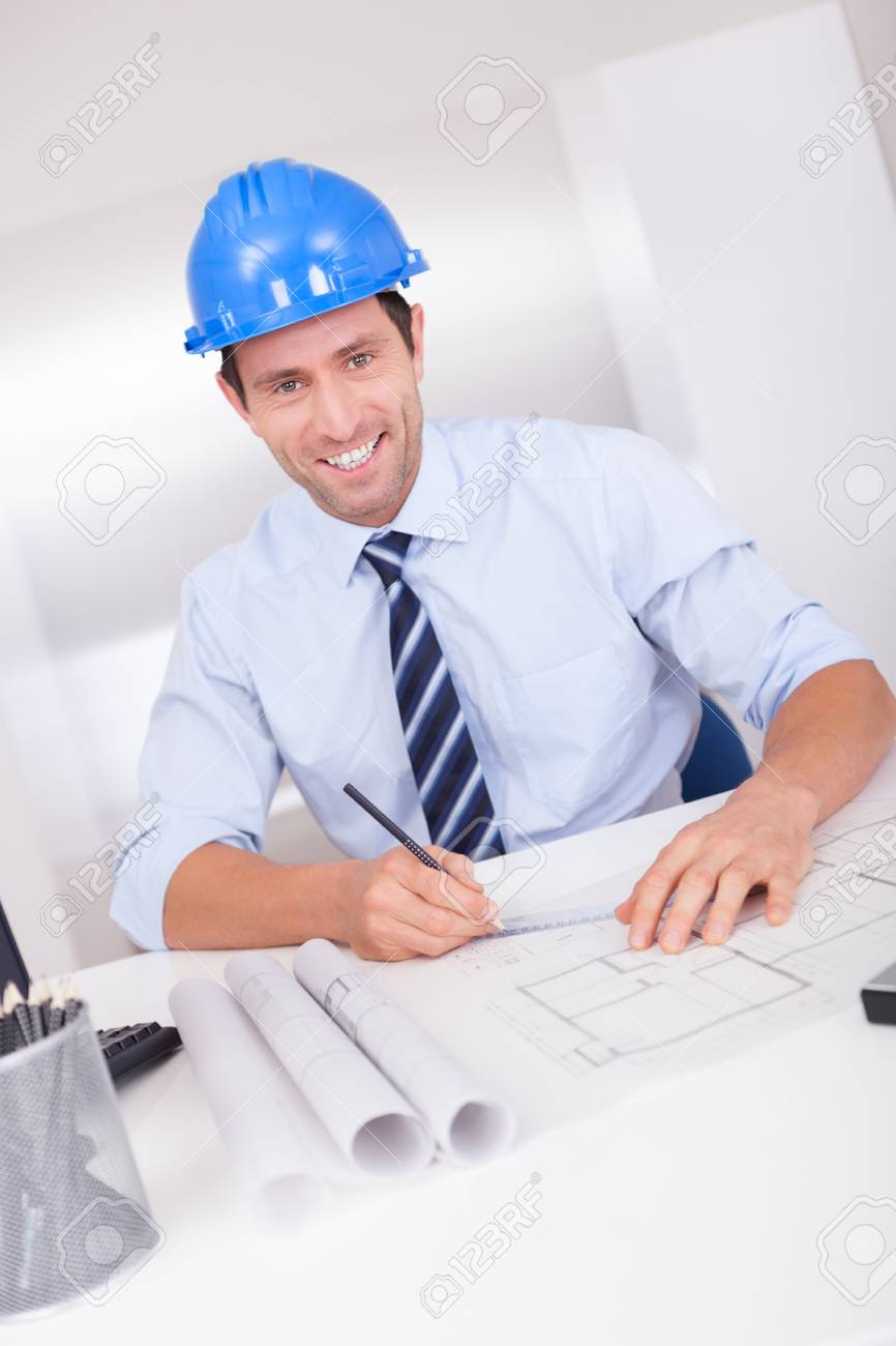 Portrait Of Architect With Blueprint In The Office Stock Photo - 15403684