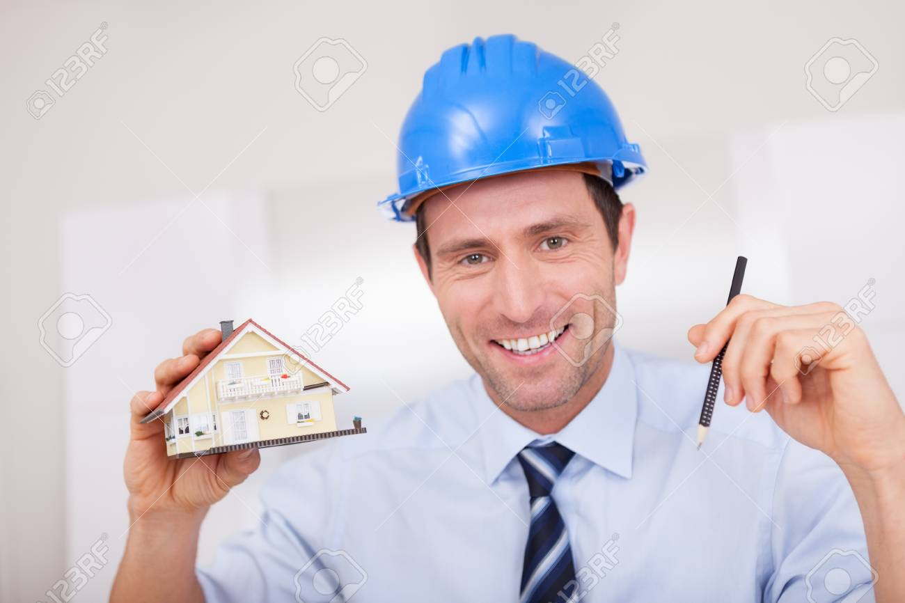 Portrait Of A Cheerful Architect Holding A House Model Stock Photo - 15403965