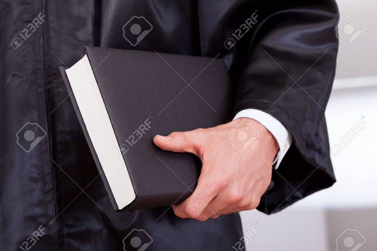 Close-up Photo of Judge Holding The Book Stock Photo - 15387942
