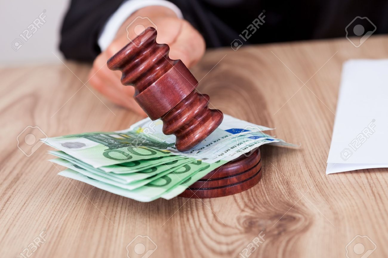 Male Judge Striking The Gavel Euro Note In A Courtroom Stock Photo - 15388033