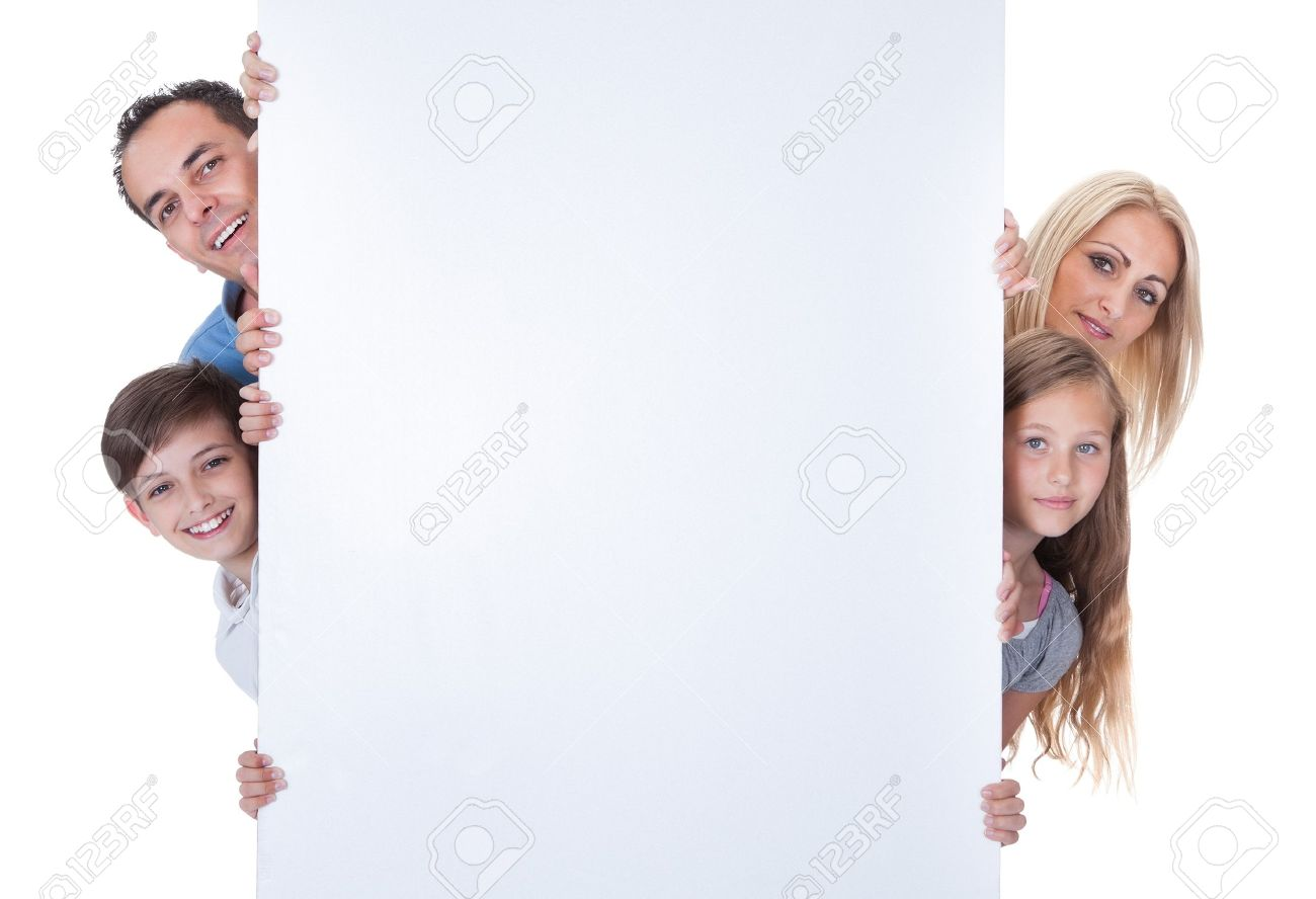 Portrait Of Family With Two Children Peeping Behind Blank Board On White Background Stock Photo - 15574815