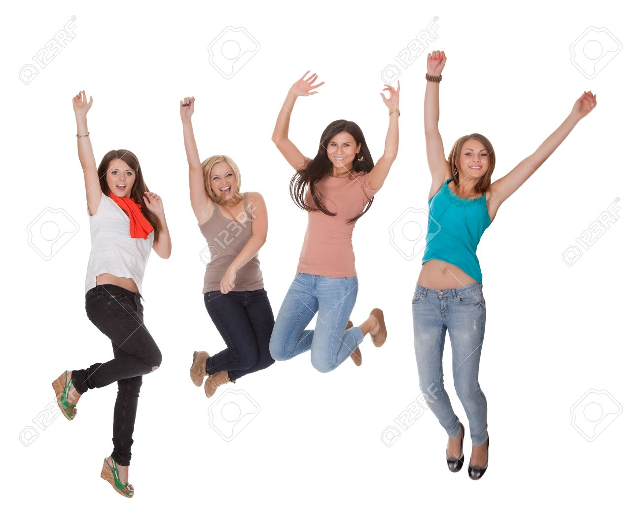 four excited young woman jumping for joy with their hands raised