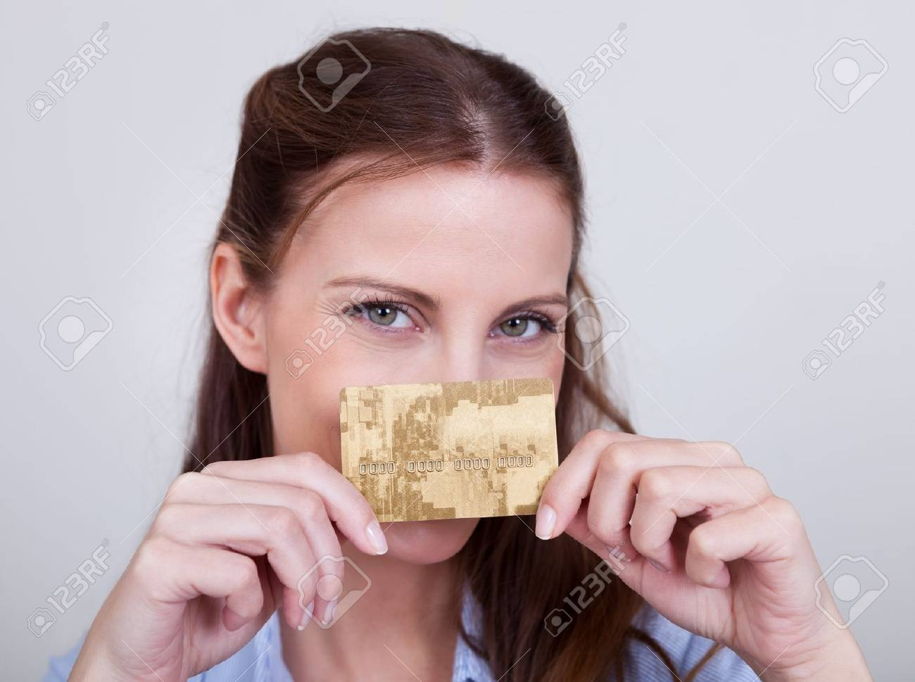 Young woman seated at her laptop entering her credit card details while shopping online Stock Photo - 16336679