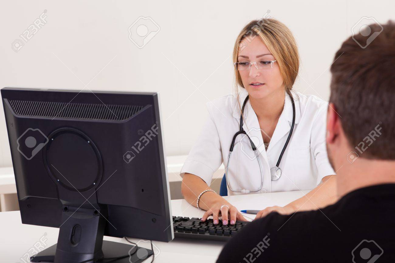 Physician explains the procedure before doing this to him. Stock Photo - 16522112