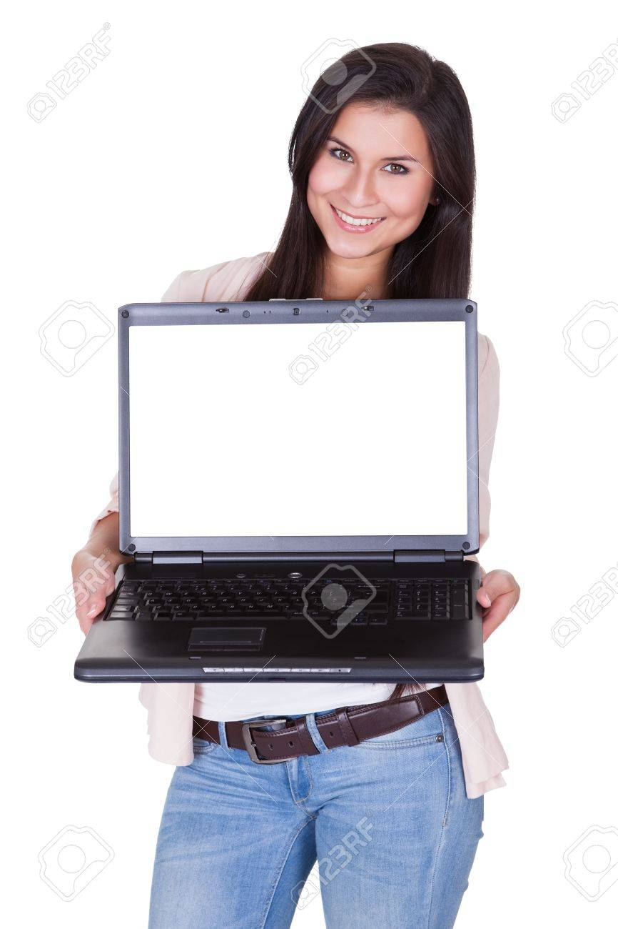 Beautiful charming woman holding a laptop facing the camera with a blank white screen for your text or advertising Stock Photo - 16522452