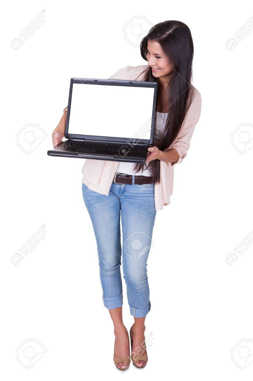 Beautiful charming woman holding a laptop facing the camera with a blank white screen for your text or advertising Stock Photo - 16522670