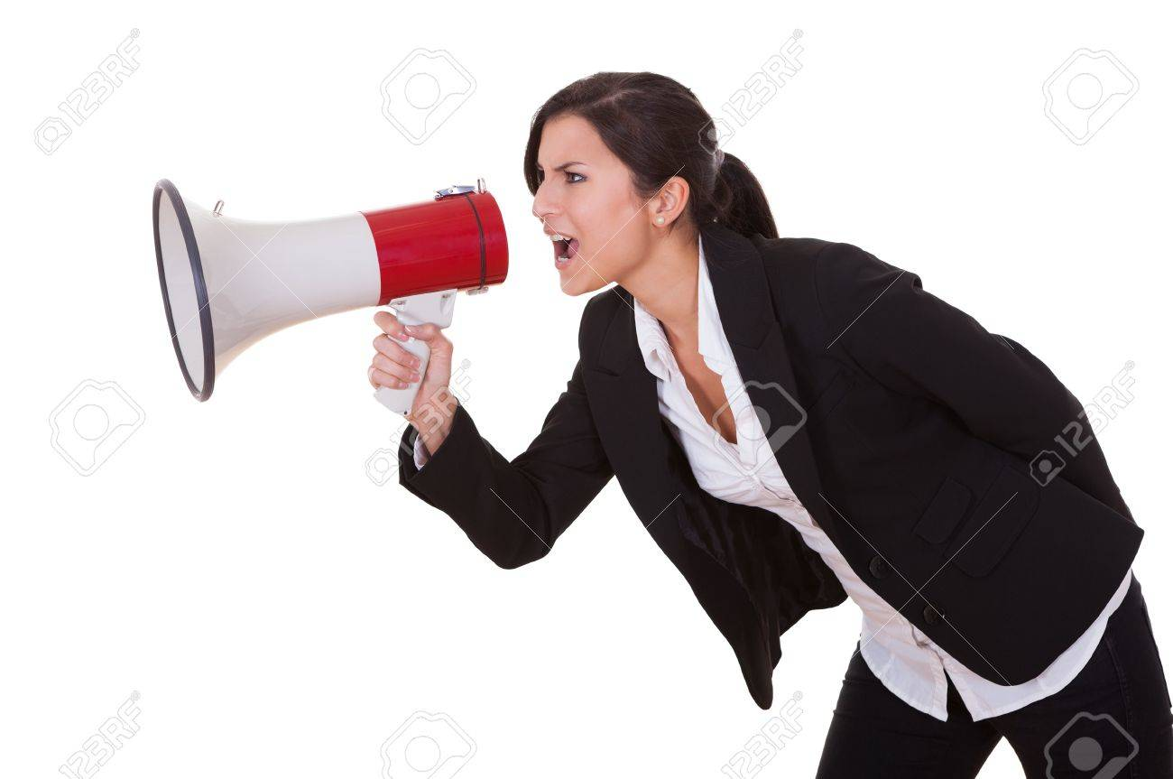 Woman shouts through a megaphone. Studio shot over white Stock Photo - 16522676