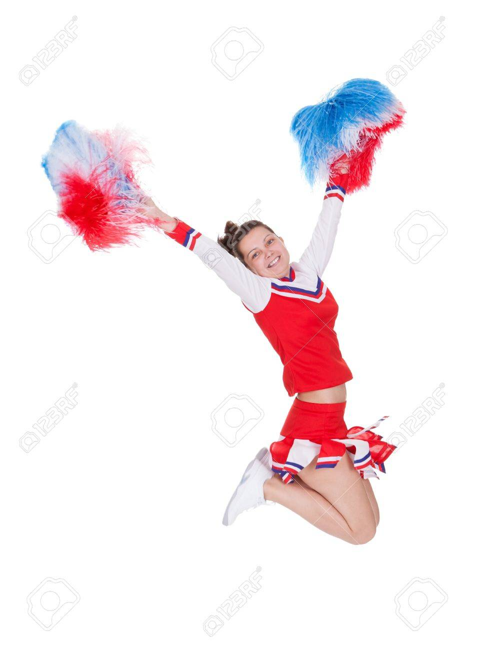 Cheerful attractive young teenage cheerleader in her red Stock Photo - 17260724