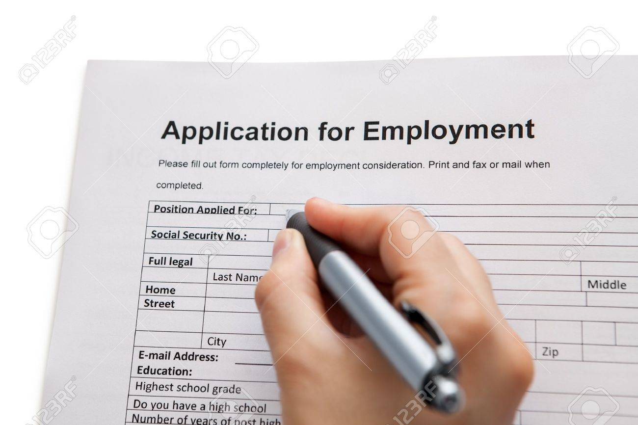 Closeup Of A Male Hand Holding A Pen Completing A Job Application ...