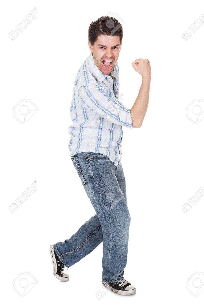 Casual handsome young man in jeans shouting for joy raising his hands above his head Stock Photo - 17384593