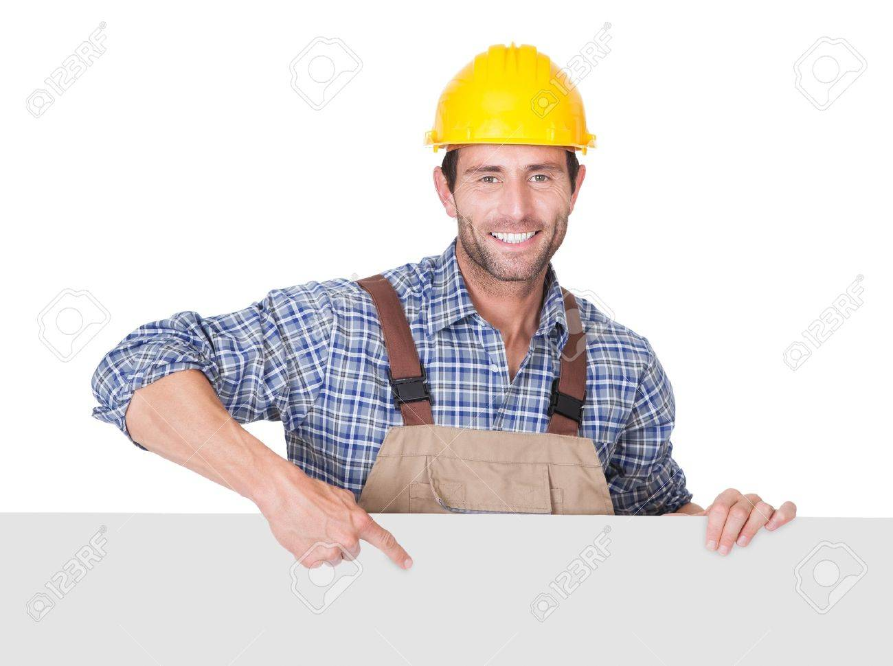 portrait of happy construction worker presenting empty banner