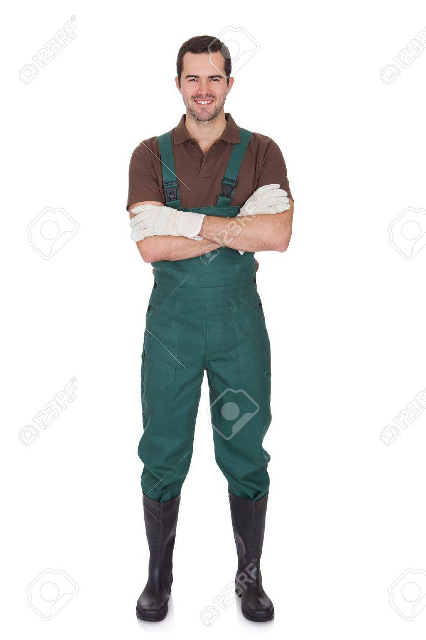 Happy young gardener in dungarees. Isolated on white Stock Photo - 18065027