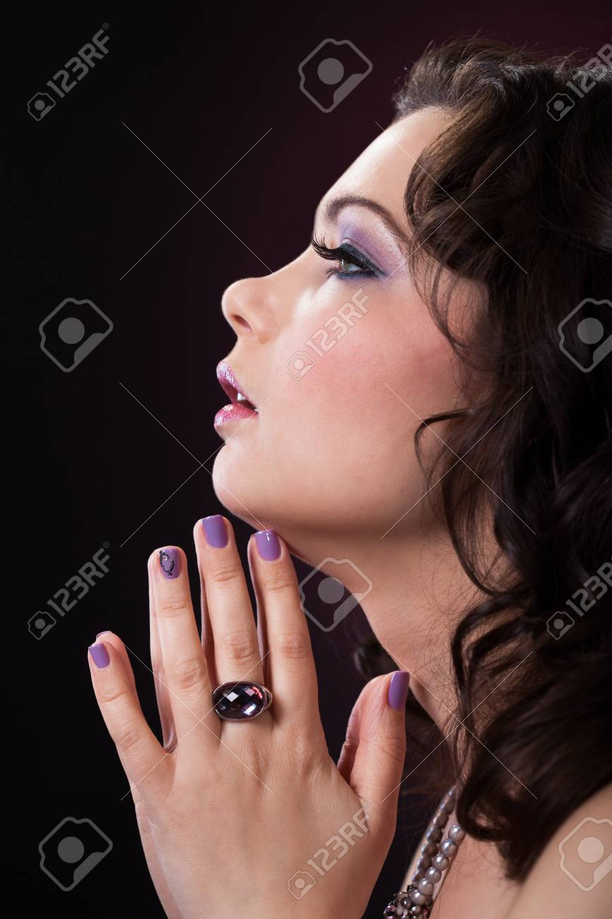 Close-up Of Beautiful Young Woman over black background Stock Photo - 18337167