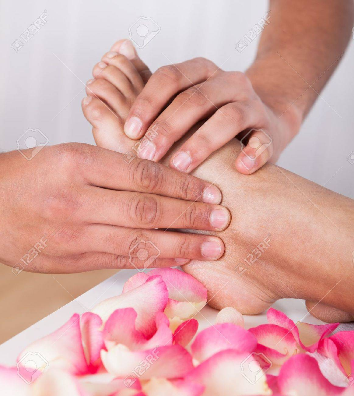 Close-up Of Hand Massaging Foot In Spa Stock Photo - 19382967