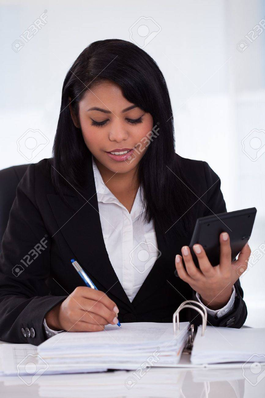 Portrait Of Young Businesswoman Doing Calculations In The Office Stock Photo - 20067525