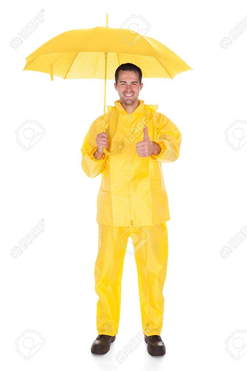 Mature Man Wearing Raincoat And Holding Umbrella Over White Background Stock Photo - 20201932