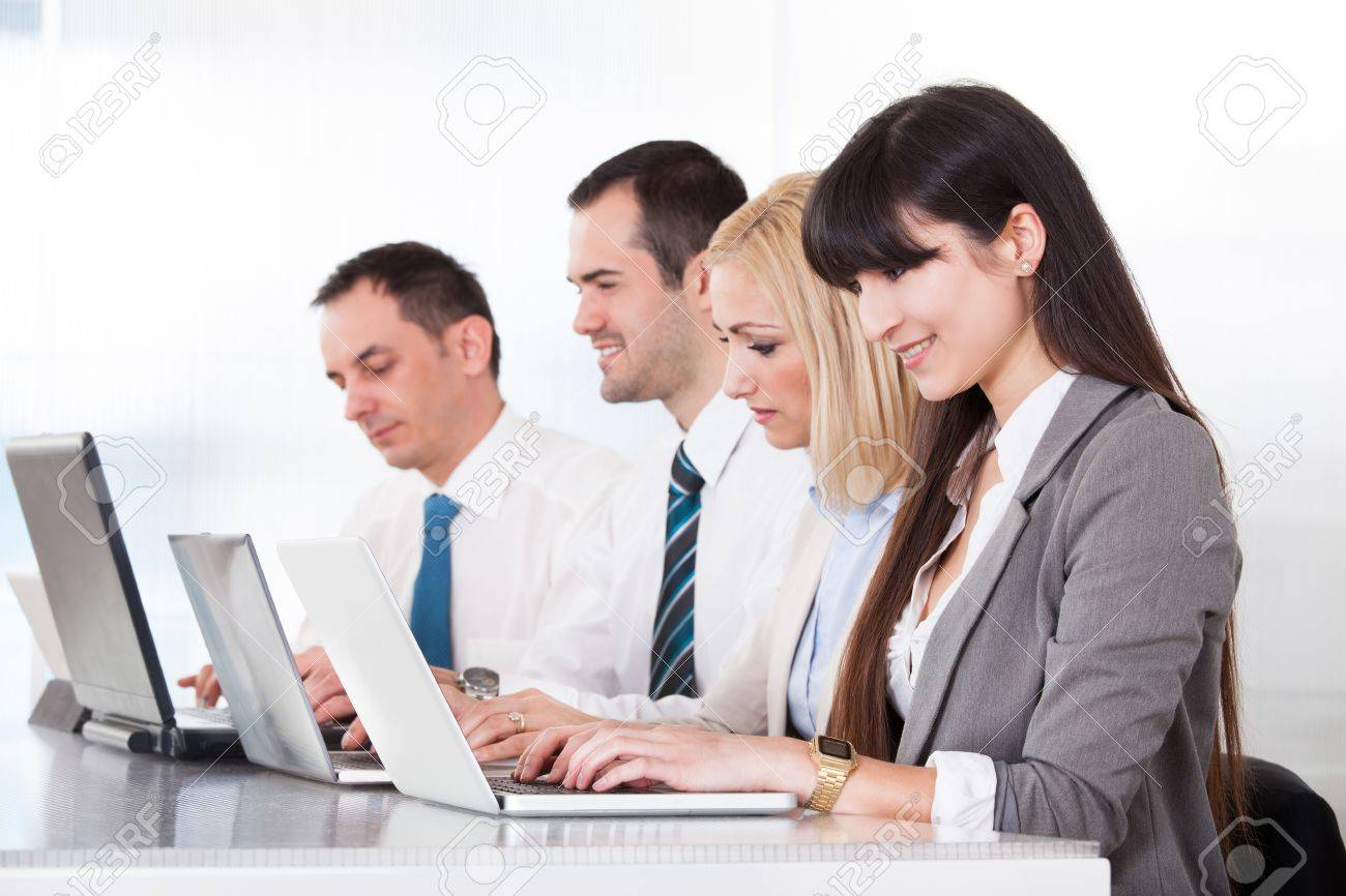 Business People Working On Laptop In Office Stock Photo - 20505001