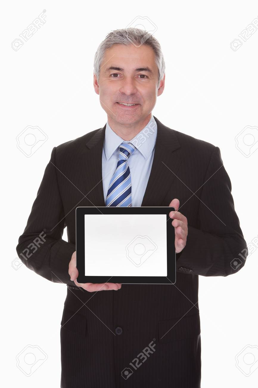 Mature Businessman Showing Digital Tablet Over White Background Stock Photo - 20504803
