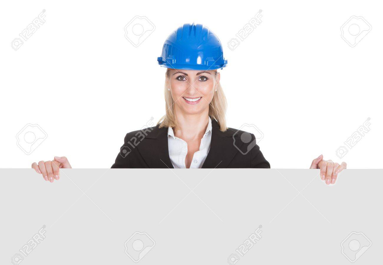 Portrait Of Happy Female Architect Holding Placard Over White Background Stock Photo - 20983624