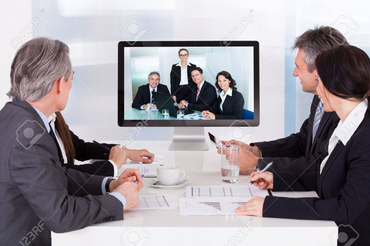 Group Of Businesspeople In Video Conference At Business Meeting ...