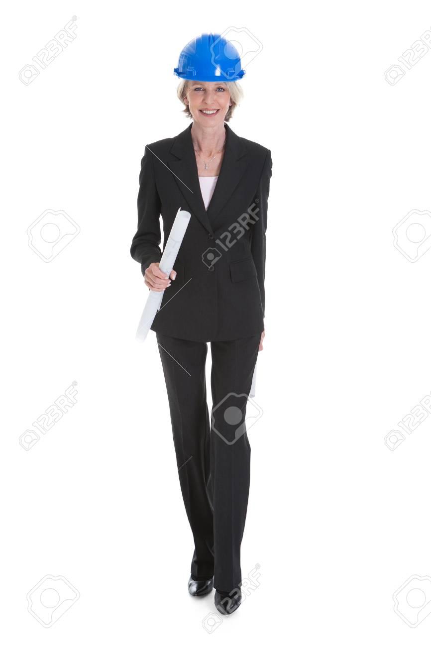 Portrait Of Happy Female Architect Holding Blue Print Stock Photo - 21328296