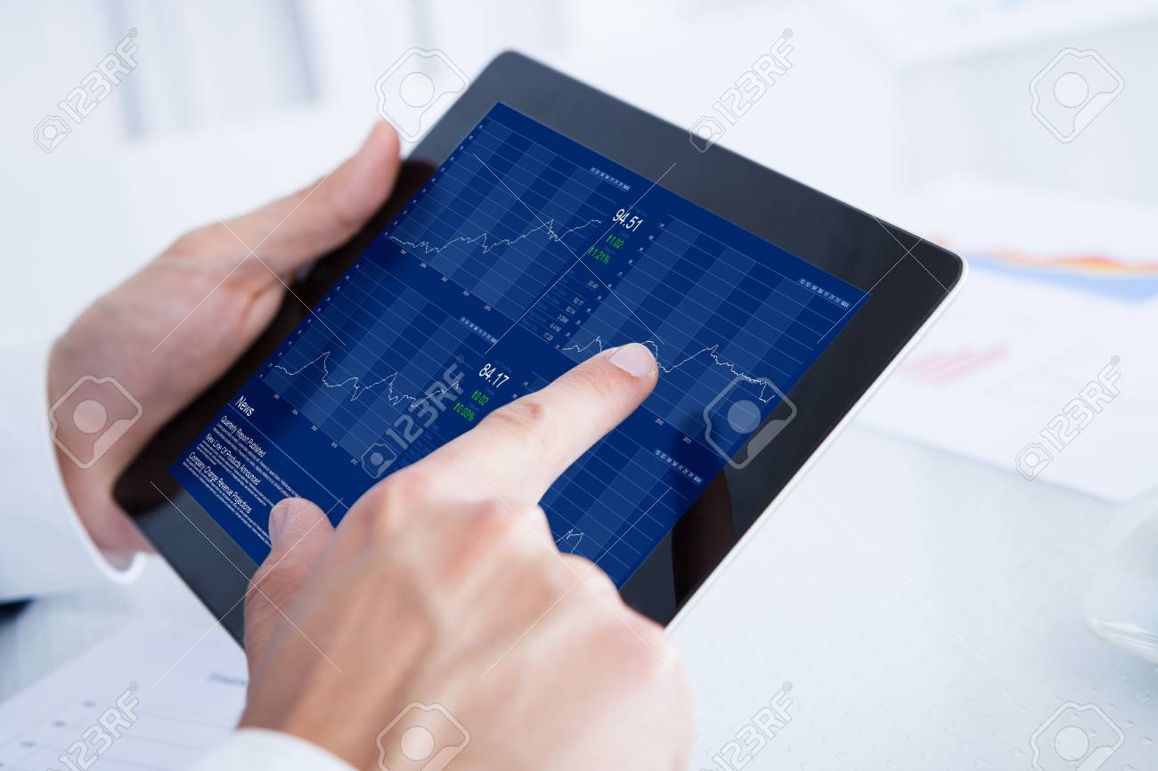 Businessman Analyzing Graph On Digital Tablet In Office Stock Photo - 21328511