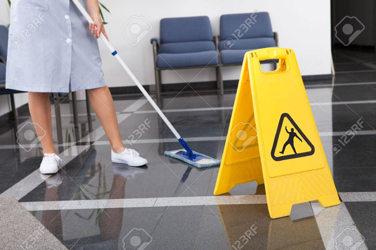Maid Cleaning The Floor With Mop In Office Stock Photo - 21328893