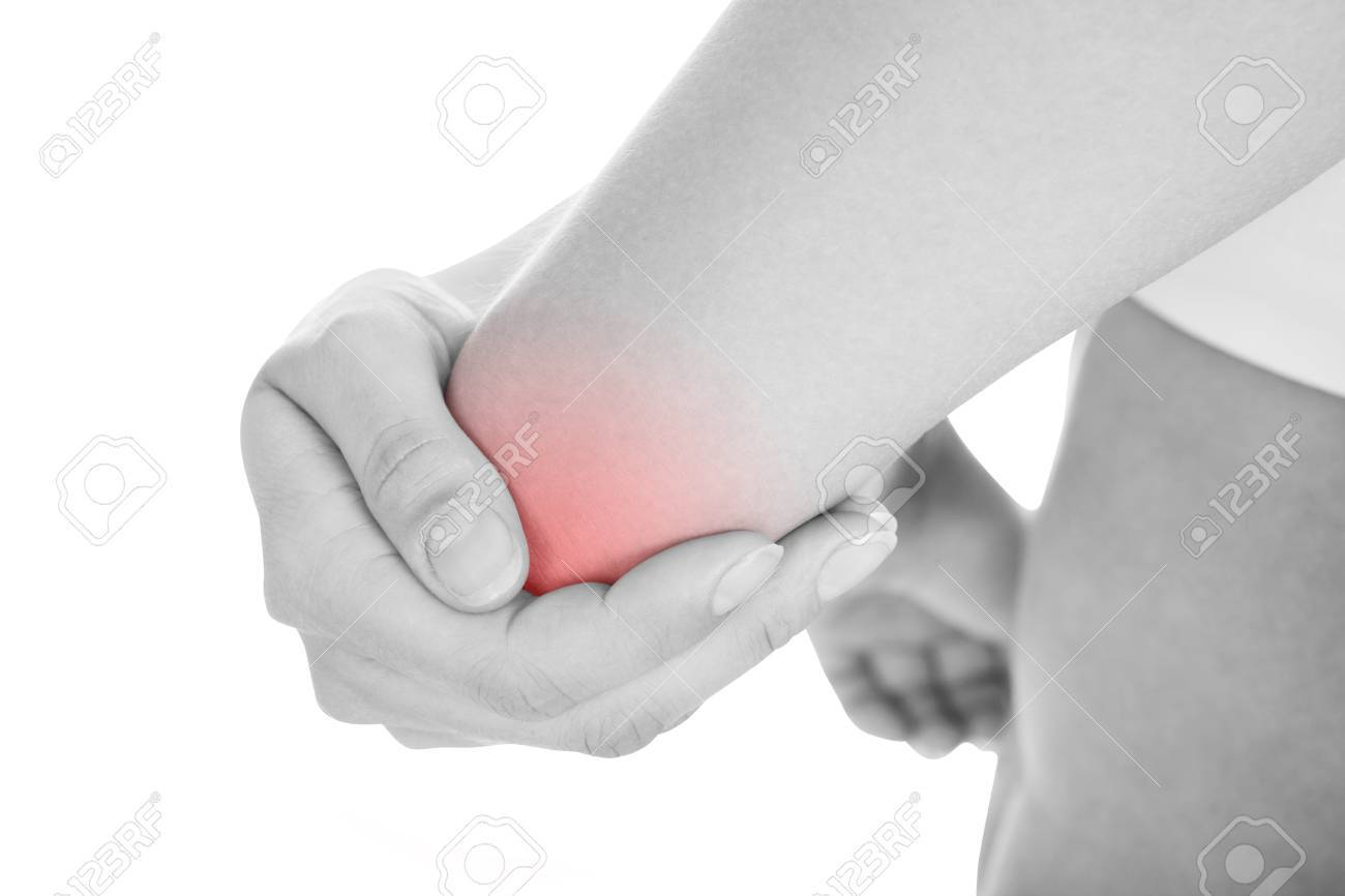 Close up of woman with elbow pain isolated on white background Stock Photo - 21329221